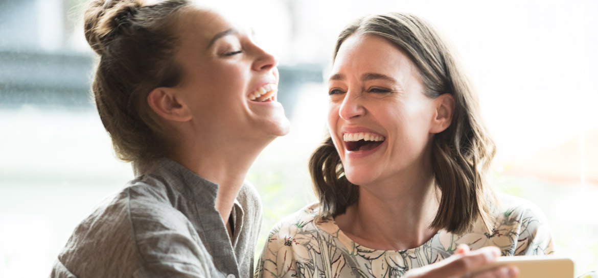 Two woman laughing with each other