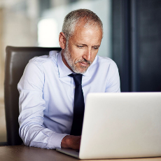 A business man typing on his computer